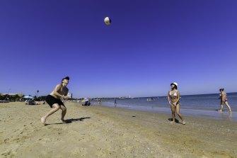 Melburnians enjoying the sunshine at St Kilda beach on Saturday.