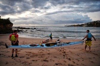Launching the kayaks before a training session: Simon Moroney, Trevor Potts and Joe McNamara.