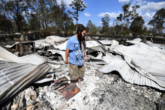 Liam McKenzie inspects the remains of his house, destroyed by bushfires in Rappville, in northern NSW.