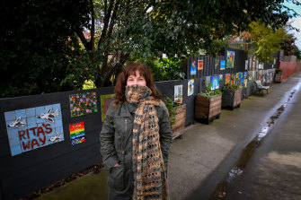 Artist Rita Santucci with some of the community arts at a laneway in Carnegie named Rita's Way by locals.