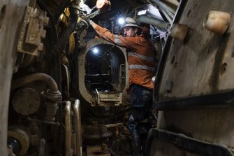 A worker operates the tunnel boring machine known as Kathleen, deep below Sydney Harbour.
