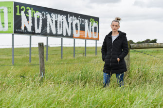 Resident Katherine Mann in front of a large Cranbourne West piece of farmland at the centre of the IBAC hearing this week.