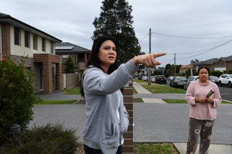 Neighbours Irada Tahpa, left, and Richielle discuss the events of Wednesday night.