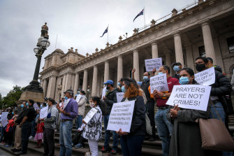 Protesters against the government's gay conversion therapy legislation on the steps of Parliament House during the debate earlier this year.