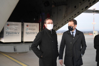Slovak Prime Minister Igor Matovic, right, and Health Minister Marek Krajci oversee the arrival of a shipment of the Russian vaccine Sputnik V into Slovakia.
