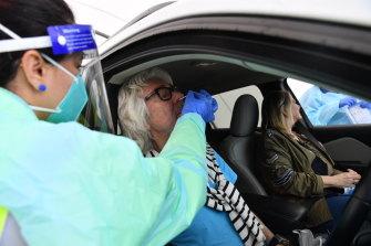 A nasal swab COVID-19 test at a drive-through clinic at Bondi Beach.