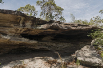 The rock shelter is part of the Cromer Heights site which contains many Aboriginal rock carvings.