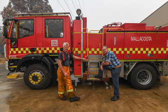Local firefighter Dean Sewell (left) battled the bushfires on New Year's Eve.