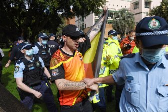 Protesters are told to move on by NSW Police.