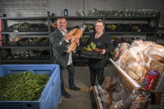Doing good: Benefactor Joe Calleja with Bk 2 Basics Melbourne founder Kelly Warren at the Narre Warren warehouse.