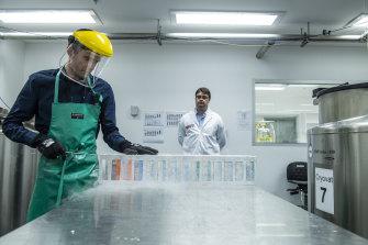 Mr Lopaticki, left, with heart samples while Associate Professor John O'Sullivan watches.