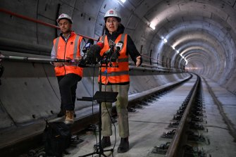 Premier Gladys Berejiklian and Transport Minister Andrew Constance inside the new cross-harbour metro tunnel between Blues Point and Barangaroo.