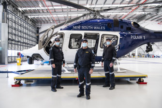 PolAir pilot, Senior Constable Jonathan Smith, aviation commander, Special Constable Kevin Drake, and  crewman, Senior Constable Rod Rankin after locating three-year-old Anthony Elfalak.