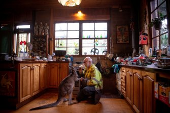 Mr Zabinskas with a kangaroo at his property in Trentham East.