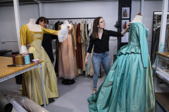 Owner of the Sydney Costume Workshop, Leonie Grace and costume associate Jude Loxie with wardrobe items from the musical Hamilton.