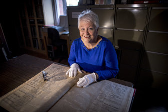 Janine Rizzetti of the Heidelberg Historical Society pores over old copies of the Heidelberg News and Diamond Creek Chronicle.