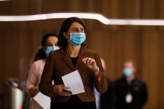 Gladys Berejiklian enters the COVID-19 briefing on Wednesday.