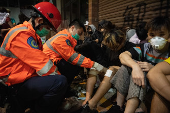 Injured anti-government protesters are treated by medics at Hong Kong Polytechnic University last month.