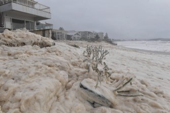 Sea foam whipped up by the strong powerful surf begins to inundate properties along Collaroy.