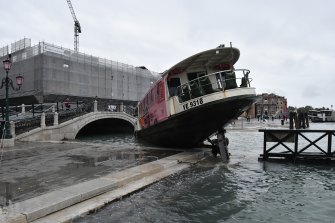 A stranded ferry in flood-hit Venice.