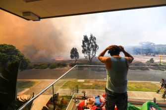 Ange Vlahopoulos watches as the fire approaches his home on Clovemont Way, Bundoora.
