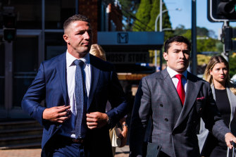Former rugby league star Sam Burgess, left, arrives at Moss Vale Local Court.