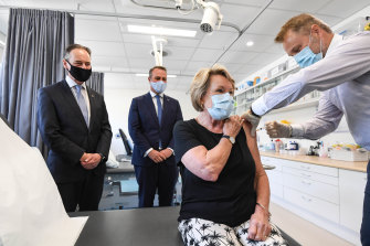 Health Minister Greg Hunt, Liberal MP Tim Wilson, patient Dale Austin and Dr Nick Kokotis in Melbourne on Monday.