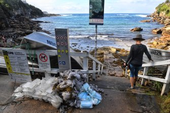 Surgical masks and other refuse that washed up last May are part of Marina DeBris' collection.