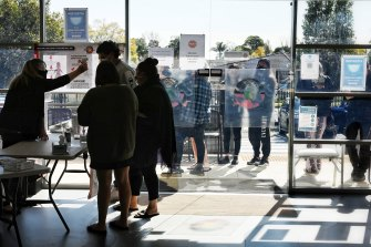 Indigenous teenagers line up to get vaccinated at the Tharawal Aboriginal Medical Service.