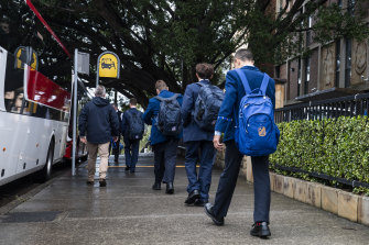 Waverley College students leave school after a student tested positive to COVID-19 on Tuesday.