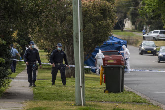 Police on William Street, Blacktown, on Thursday morning after an 18-year-old man was fatally stabbed.