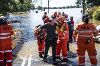 State Emergency Services assisting people affected by large floods near Sydney in March.