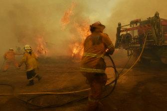 Rural Fire Service volunteer firefighters battle spot fires at Hillville.