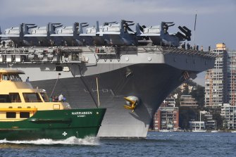 USS Wasp entering Sydney Harbour before joining Exercise Talisman Sabre in Queensland.