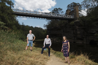 Kangaroo Valley residents Gary Moore, Matt Gray and Kate Watson beneath the Hampden Bridge.