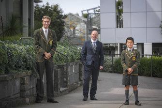 Trinity Grammar principal Adrian Farrer with school captain Jack Stewart and junior school captain Wes Collins.