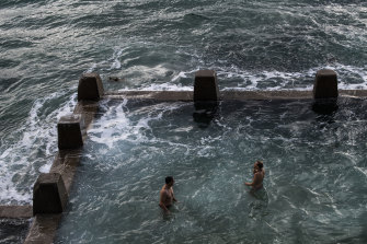 Swimmers practise social distancing in the ocean pool at Coogee.