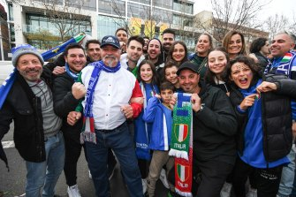 Rosa Mobilio (top right) and her extended family were among the hundreds of Italian soccer fans who turned out at Lygon Street.