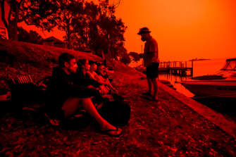Day turns to blood red night in Mallacoota on Saturday as families wait for relief.