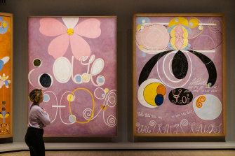 A viewer takes in Hilma af Klint's The Ten Largest collection, part of her show The Secret Paintings at the Art Gallery of NSW.