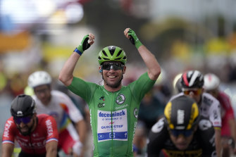 Britain's Mark Cavendish celebrates as he crosses the finish line to win the tenth stage of the Tour de France.