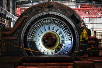 A demolition worker examines a Siemens turbine within the main power plant at Wallerawang.