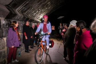 'We don't eat billy goats': The Trolls choir serenades a cyclist.
