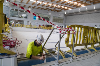 A worker in the indoor swimming area of the new Ashfield Aquatic Centre.