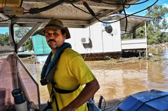 Wayne Smith searches for missing vans from his caravan park last week.