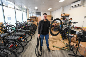 Andres Puerto from Colombia is making a living renting e-bikes but says his fellow international students are struggling.