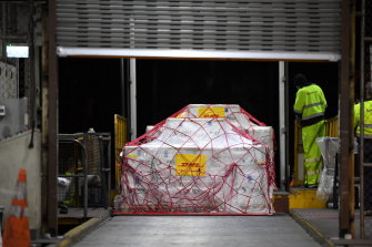 A pallet of Pfizer vaccines is unloaded at the Qantas freight terminal after landing on Qantas flight QF10 from London at Kingsford Smith International Airport.