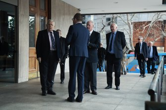 Men arrive at the men's only Australian Club to vote on whether women can be admitted as members.