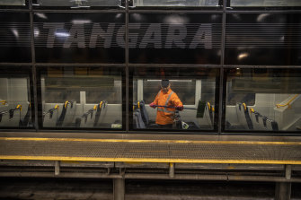 A cleaner on a Tangara train at the Mortdale depot.