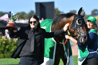 Matthew Gudinski with Homesman, which was owned by his father Michael Gudinski, after the Australian Cup victory on Saturday.